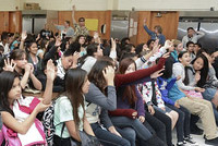 Fort Miller students raising hands at assembly